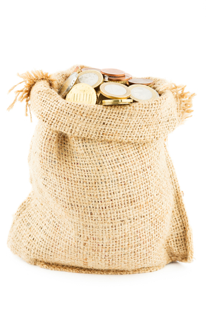 accumulations: a chinks in a linen sack isolated on a white background coins