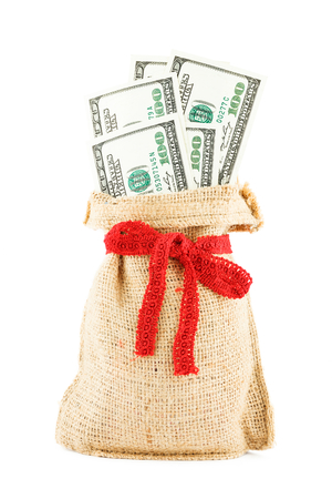 accumulations: The dollars in a linen sack, bandaged by a gift red ribbon, isolated on a white background