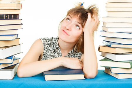 recite: Girl with books isolated on white background. portrait of a student. Stock Photo