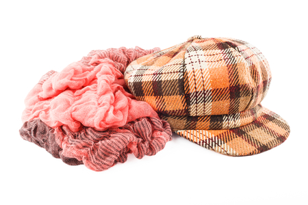 Woolen scarf and cap isolated on white background.  Brown female accessory . photo