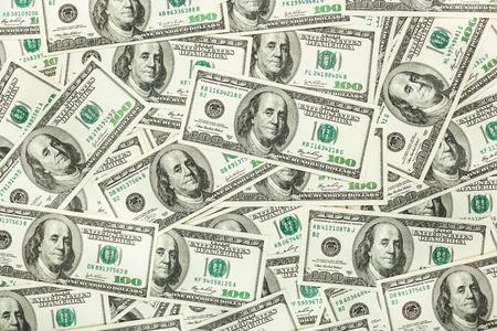 dolar: El papel moneda y el dolar. fondo de los billetes para el protector de pantalla en el monitor.