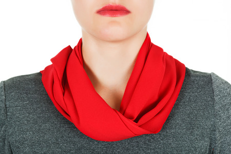 Silk scarf. Red silk scarf around her neck isolated on white background. Female accessory.