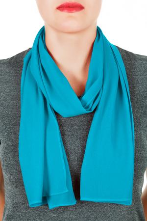 silk scarf: Silk scarf. Blue silk scarf around her neck isolated on white background. Female accessory.