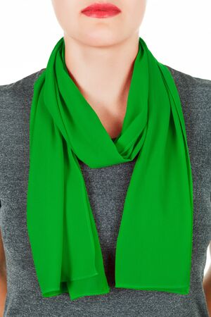 scarf: Silk scarf. Green silk scarf around her neck isolated on white background. Female accessory.