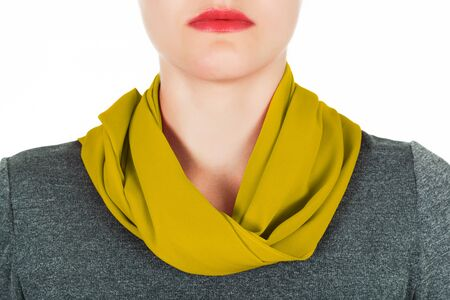 silk scarf: Silk scarf. Yellow silk scarf around her neck isolated on white background. Female accessory.