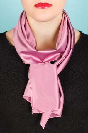 silk scarf: Silk scarf. Pink silk scarf around her neck isolated on white background. Female accessory. Stock Photo