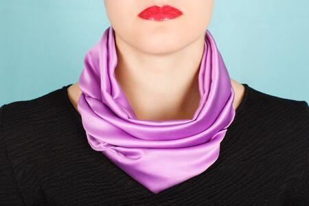 silk scarf: Silk scarf. Lilac silk scarf around her neck isolated on blue background. Female accessory.