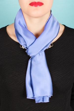 silk scarf: Silk scarf. Blue silk scarf around her neck isolated on blue background. Female accessory.