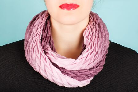 silk scarf: Silk scarf. Pink silk scarf around her neck isolated on blue background. Female accessory.
