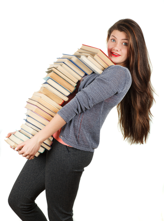Girl with books isolated on white background. Portrait of a student. Stock Photo