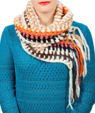 Woolen scarf. Beige woolen scarf around her neck isolated on white background. Female accessory.