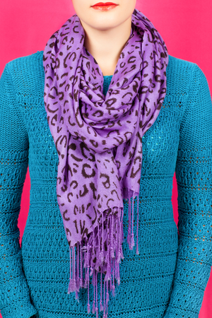 Silk scarf. Lilac silk scarf around her neck isolated on pink background. Female accessory.