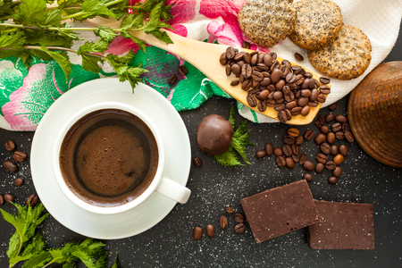 mea: Coffee in white cup on black background. Turkish coffee and biscuits for breakfast. Stock Photo