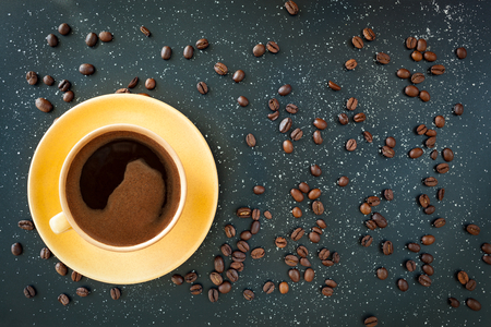 mea: Coffee in yellow cup on black background. Turkish coffee for breakfast. Stock Photo