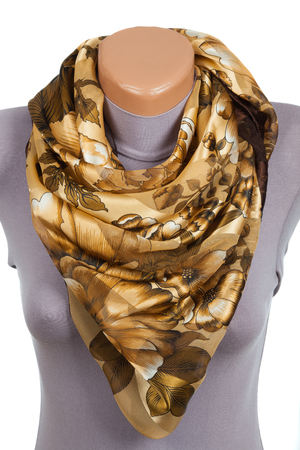 Beige scarf on mannequin isolated on white background. Female accessory. Фото со стока - 90465171