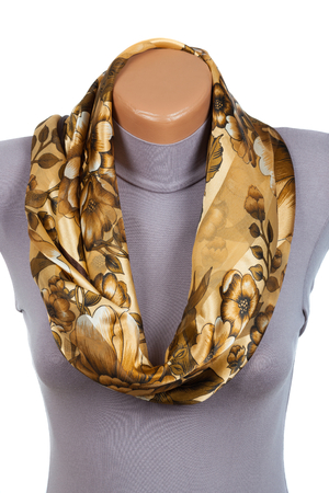 Beige scarf on mannequin isolated on white background. Female accessory. Фото со стока