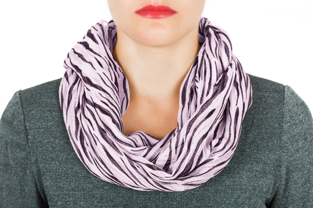 Silk scarf. Lilac silk scarf around her neck isolated on white background. Female accessory. Stock Photo