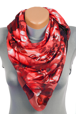 Red scarf on mannequin isolated on white background. Female accessory. Фото со стока