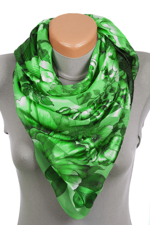 Green scarf on mannequin isolated on white background. Female accessory. Stock Photo
