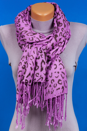 Lilac scarf on mannequin isolated on blue background. Female accessory.