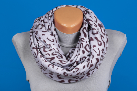 Gray scarf on mannequin isolated on blue background. Female accessory. Фото со стока - 93802228