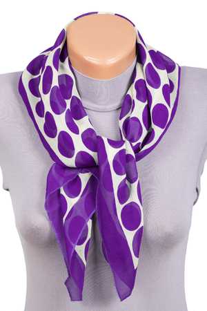 Lilac scarf on mannequin isolated on white background. Female accessory. Фото со стока