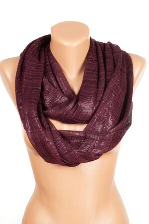 Burgundy scarf on mannequin isolated on white background. Female accessory.