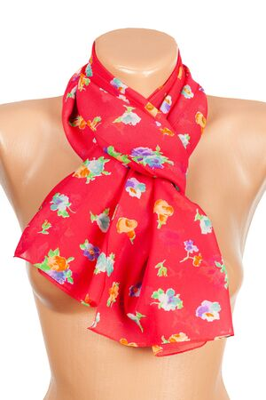 Red silk scarf on mannequin isolated on white background. Female accessory.