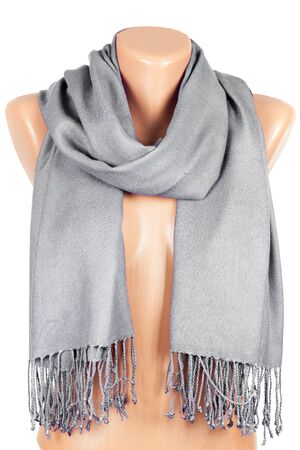 Gray scarf on mannequin isolated on white background. Female accessory.