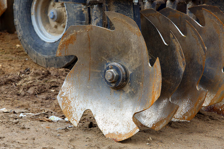 plough machine: Disc harrow used to cultivate the soil. close-up Stock Photo