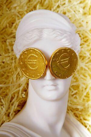 greek goddess: The Greek goddess Aphrodite with euro coins on the eyes