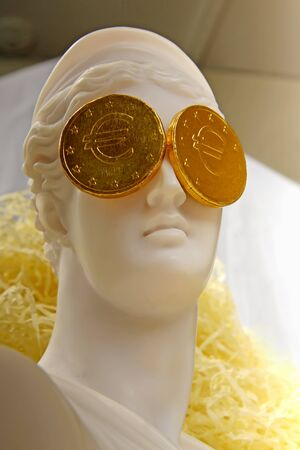 greek coins: The Greek goddess Aphrodite with euro coins on the eyes
