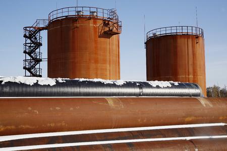 crude: Tank storage crude Oil in winter landscape