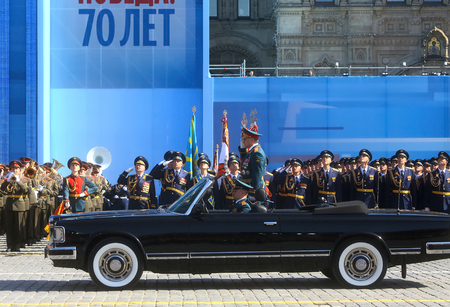 minister of war: MOSCOW,07 MAY,2015: Russian defense Minister, Army General Sergei Shoigu rides in a limo at the Red Square in Moscow during the final rehearsal of the military parade to mark the Victory day