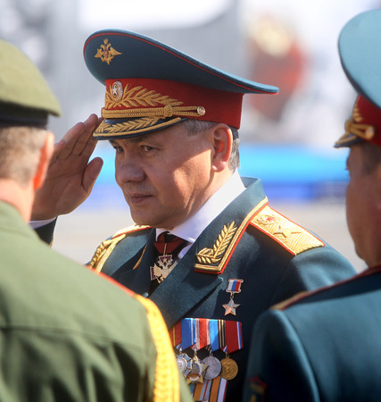 minister of war: MOSCOW,07 MAY,2015:Defense Minister, Army General Sergei Shoigu at the final rehearsal of the military parade to mark the 70th anniversary of Victory in the 1941-1945 Great Patriotic War on Red Square Editorial