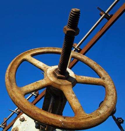 damage control: Oxidation rust pipeline valve, closeup of photo Stock Photo