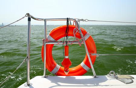 Lifebuoy on a yacht side. Concept of safe sea walk. Stock Photo