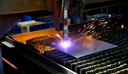 Industrial cnc plasma cutting of metal plate. Sparks fly. Closeup
