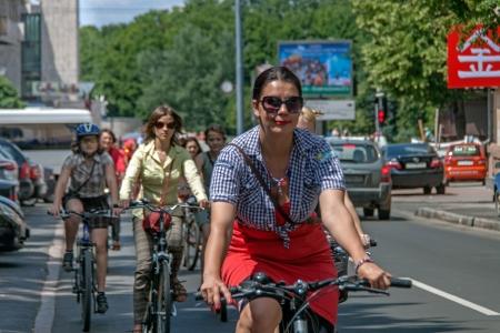 v cycle: KHARKIV, UKRAINE - JUNE 08: Bicycle Action Girls in plaid in Kharkiv, Ukraine on June 08, 2013