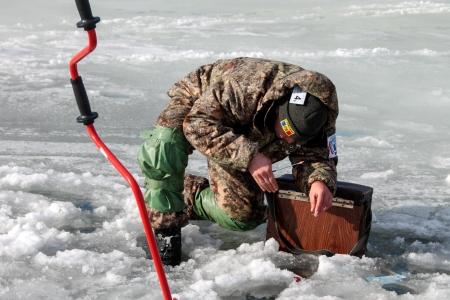 v lake: KHARKIV REGION, UKRAINE - FEBRUARY 6: Eighth World Ice Fishing Championship in Kharkiv region on February 5-6, 2011 Editorial