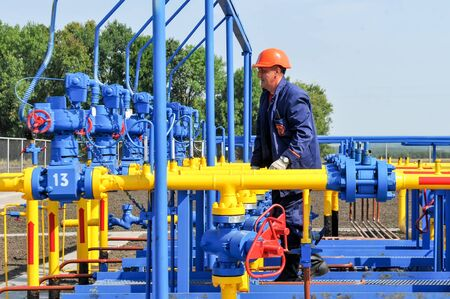 condensate: KHARKIV OBLAST, UKRAINE - AUGUST 11, 2015: Employee working on the gas treatment plant into operation at the oil and gas condensate deposit