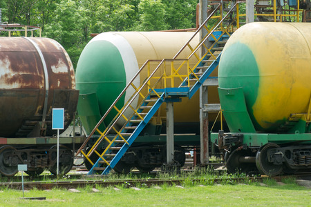 fuel tanks: Old fuel tanks at the oil terminal on railway station on a summer day Stock Photo