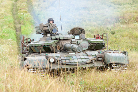 armoring: Main battle tank at a firing range in summer day