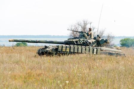armoring: Kharkiv, Ukraine - August 12, 2016: Main battle tank at a firing range Editorial