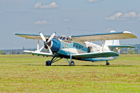 KHARKIV, UKRAINE - AUGUST 20, 2016: Antonov An-2 aircraft (USAF  DoD reporting name Type 22, NATO reporting name Colt) parked at the airport Korotych, Kharkov region, Ukraine on August 20, 2016 Editorial