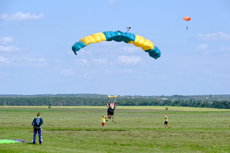 parachute jump: Paraglider landed after the jump at a bright sunny summer day. Active lifestyle, extreme hobbies