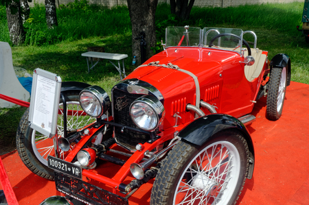 Kharkiv, Ukraine - May 22, 2016: Retro car red Fiat Roadster manufactured in 1949 is presented at the festival of vintage cars Kharkiv Retro Rally - 2016 in Kharkiv, Ukraine on May 22, 2016 Editorial