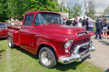 Kharkiv, Ukraine - May 22, 2016: Retro car cherry-blossom GMC Model 101 12-Ton Suburban Pickup Truck manufactured in1950s is presented at the festival of vintage cars Kharkiv Retro Rally - 2016 in Kharkiv, Ukraine on May 22, 2016