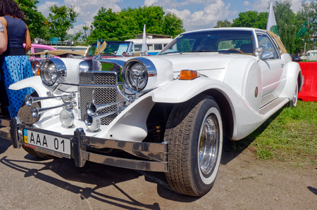 luxuriance: Kharkiv, Ukraine - May 22, 2016: Neo-classic motor car white Zimmer Golden Spirit manufactured in 1982 is presented at the festival of vintage cars Kharkiv Retro Rally - 2016 in Kharkiv, Ukraine on May 22, 2016