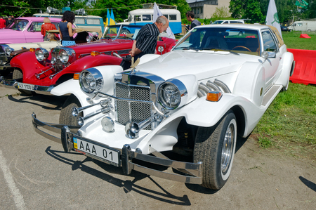 neoclassic: Kharkiv, Ukraine - May 22, 2016: Neo-classic motor car white Zimmer Golden Spirit manufactured in 1982 is presented at the festival of vintage cars Kharkiv Retro Rally - 2016 in Kharkiv, Ukraine on May 22, 2016